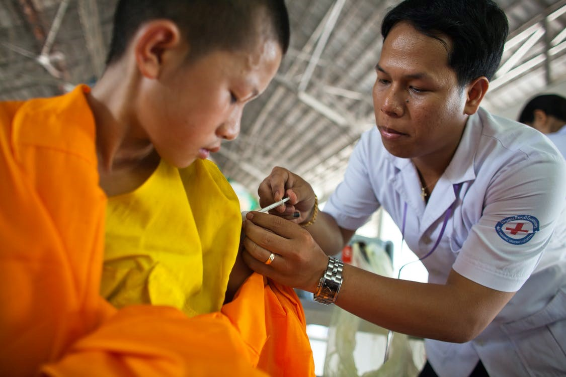 Nurses assisting patients